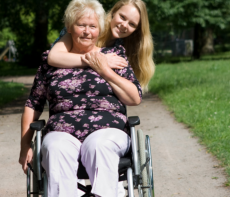 Elder female in wheelchair with staff
