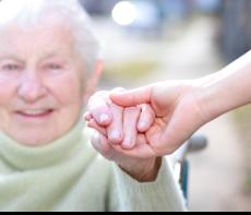 Hodling the hand of a senior female